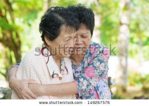 stock-photo-candid-shot-of-an-asian-mature-woman-hugs-and-consoling-her-crying-old-mother-at-outdoor-natural-149267576