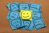 8096109-positive-attitude-or-optimism-concept--happy-smiley-face-on-yellow-sticky-note-surrounded-by-sad-unh